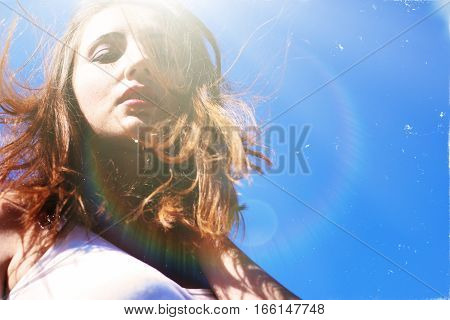 Seductive young woman on a windy day.