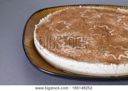 Christmas coffee cake with creamy souffle decorated star.