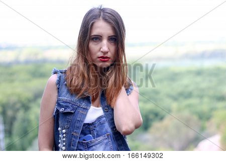 Attractive woman posing against the backdrop of forest.