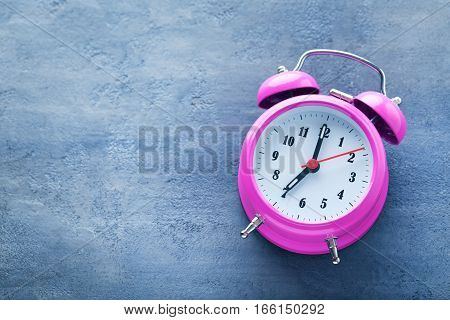 Pink Alarm Clock On Grey Wooden Table