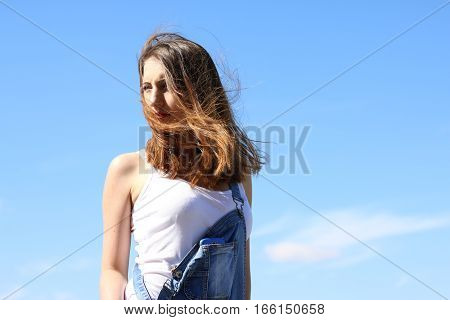 Seductive young woman on a windy day. wind blowing hair
