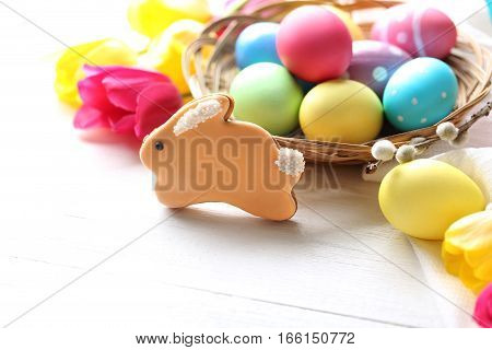 Easter Eggs With Cookies On A White Wooden Table