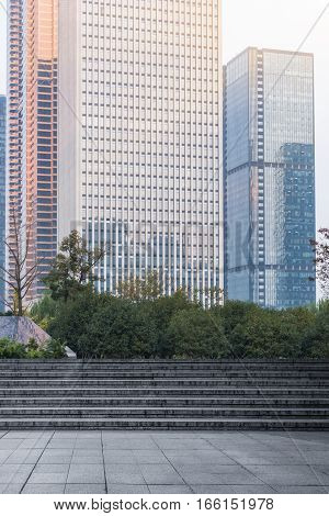 stone steps with modern office buildings background, shanghai, china.