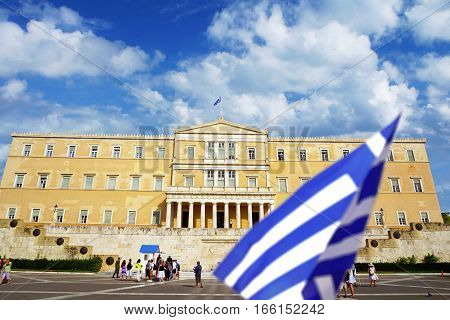 ATHENS - SEPTEMBER 9: People walk around the Greece parliament on Syntagma square on summer sunny day on 9th of September, 2016 in the Athens.