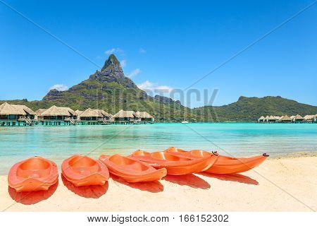 Kayaks on white sand beach Bora Bora Tahiti French Polynesia South Pacific Concept for relaxation vacation resort