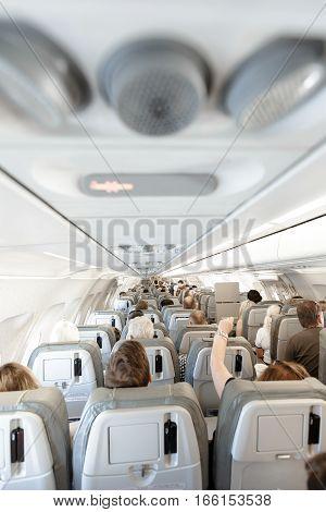Zaporozhye, Ukraine - August 22, 2016: Interior of airplane with passengers on seats Zaporozhye, Ukraine  August 22, 2016