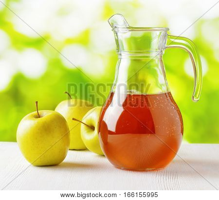 Jug Of Apple Juice On Nature Background