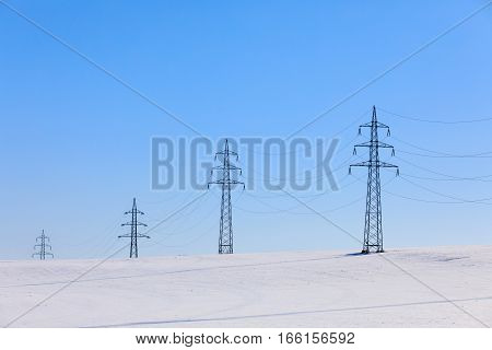 High Voltage Power Lines Against A Blue Sky