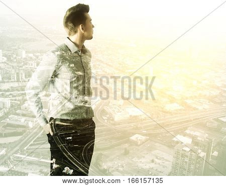 Businessman Standing Against A City