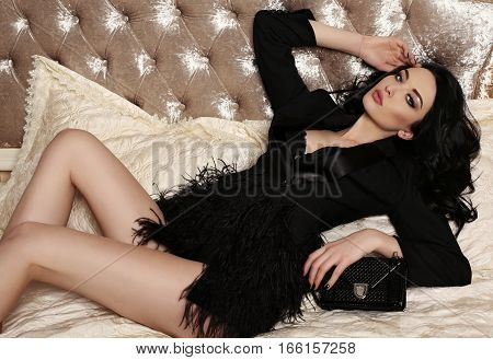 Gorgeous Woman With Dark Hair And Evening Makeup