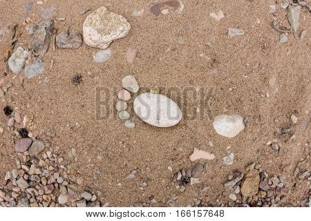 Trace Feet Made Of A Pebble Stone Close Up On The Sea Sand Desert Surface Texture Backdrop