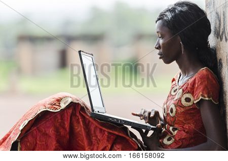 Education for Africa: Technology Symbol African Woman Studying Learning Lesson
