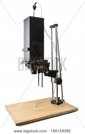 Old photographic enlarger isolated on white background