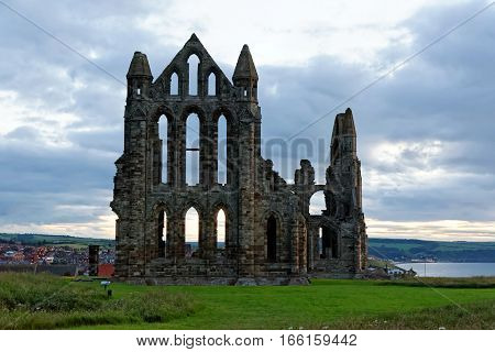Whitby on the North Yorkshire coast England. The ruins of Whitby Abbey on the East Cliff home of Caedmon the earliest recognised English poet lived.