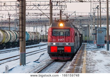 KHABAROVSK RUSSIA - JANUARY 06 2017: Electric train passing a platform at the station