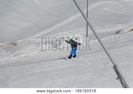 Snowboarder on slope on the skiing resort in Gudauri Georgia