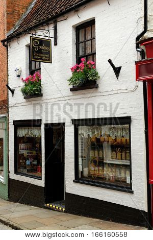 LINCOLN, UK - JULY 1, 2016: Traditional sweet shop on Strait street which leads to Steep Hill and the Cathedral in the historic quarter of Lincoln City Centre Lincolnshire.