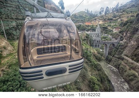August 30, 2016 Las Lajas, Colombia: descending towards the sanctuary with a cablecar crossing the deep valley