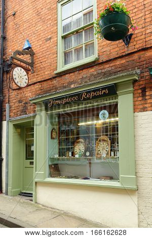 LINCOLN, UK - JULY 1, 2016: Timepiece repairs shop on Steep Hill a popular tourist street in the historic city of Lincoln. In 2011 it was named