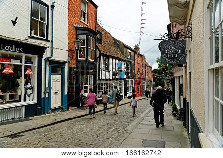 LINCOLN, UK - JULY 1, 2016: The top of Steep Hill a popular tourist street in the historic city of Lincoln. In 2011 it was named