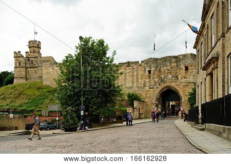 LINCOLN, UK - JULY 1, 2016: Stone gatehouse east gate entrance to Lincoln Castle. It is constructed in the late 11th century by William the Conqueror.