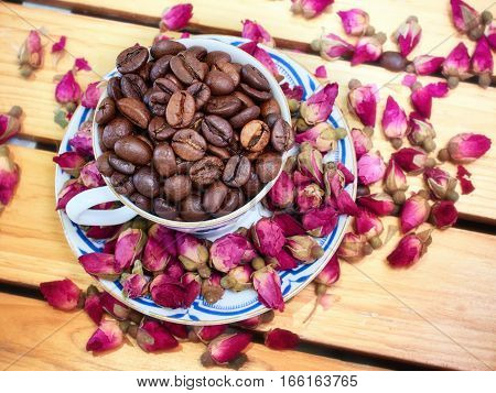 She loves tea from flowers of roses and a rose. He black coffee without sugar. They love together