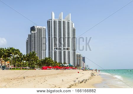 People Enjoy The Beach At Trump Tower At Sunny Isles Beach