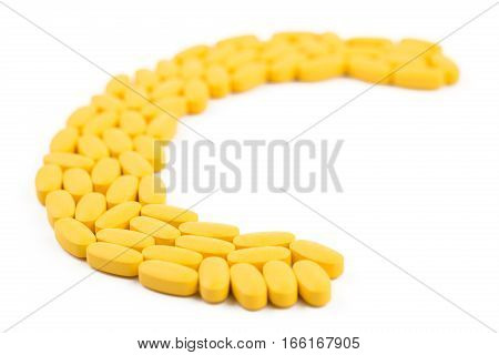 Vitamin C Pills Shaped In Letter