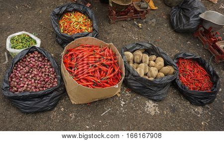 Chillies and potatoes in plastic bag photo taken in Jakarta Indonesia java