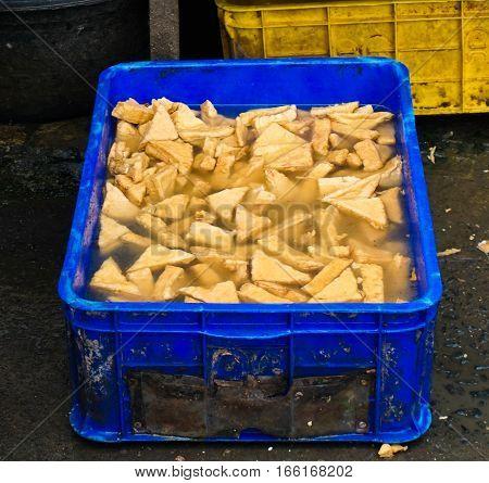 Selling yellow tofu in blue bucket photo taken in Jakarta Indonesia java