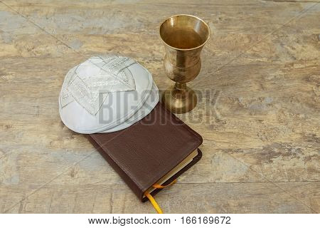 Chalice with red wine and torah holy communion book