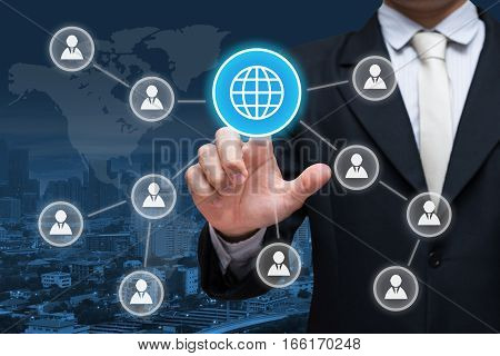 Businessman hand touch social media symbol on city background