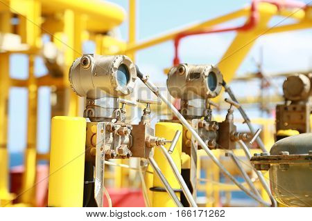 Pressure transmitter in oil and gas process, Send signal to controller and reading pressure in the system, Electronic transducer and sent data from production process to Processor Logic Controller.
