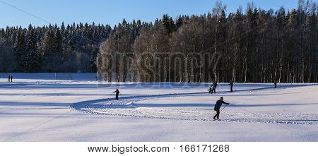 UMEA, SWEDEN ON JANUARY 14. Winter activity around an outdoor sports stadium on January 14, 2017 in Umea, Sweden. Cross country skiing. Unidentified people. Editorial use.