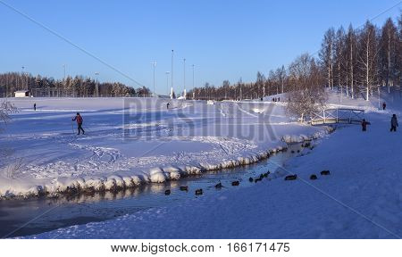 UMEA, SWEDEN ON JANUARY 14. Winter activity around an outdoor sports stadium on January 14, 2017 in Umea, Sweden. Cross country skiing. Unidentified people. Ducks this side. Editorial use.