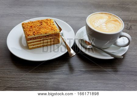 sweet cake and a Cup of coffee