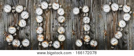2017 new year background, 2017 sign by tools or equipment on wooden background, new year idea of spare part or tools in workshop or the garage, tools and pressure gauge on wooden background.