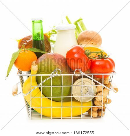Studio shot of shopping basket with groceries, side view