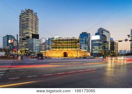 Namdaemun Gate and city skyline at night Seoul South Korea