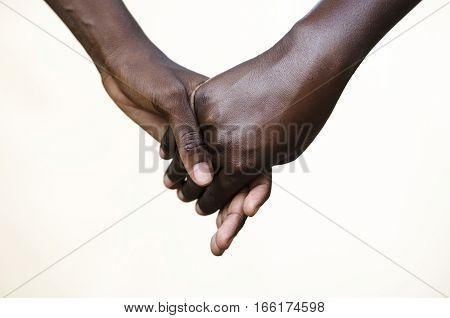 Friendship Symbol: Black People Holding Hands Together. Symbol for fight against racism peace for the world!