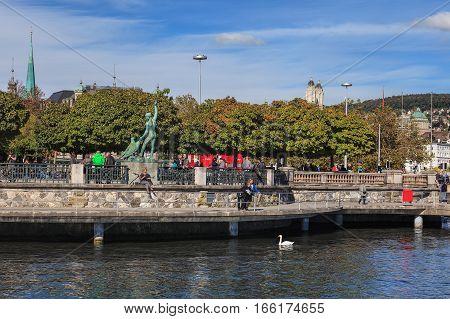 Zurich, Switzerland - 13 October, 2013: embankment of Lake Zurich in the city of Zurich. Zurich is the largest city in Switzerland and the capital of the Swiss Canton of Zurich..