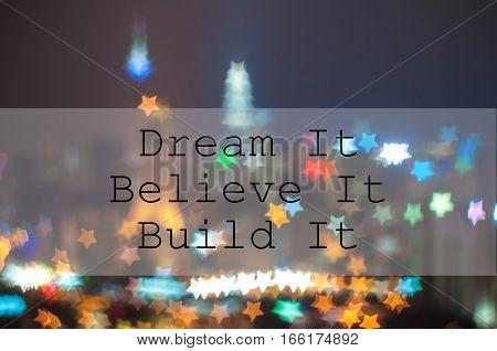 DREAM IT BELIEVE IT BUILD IT on city blur image