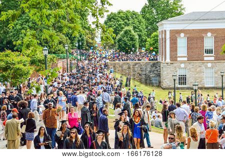 Charlottesville, USA - May 18, 2014: Crowd of people walking by amphitheater at graduation ceremony at University of Virginia