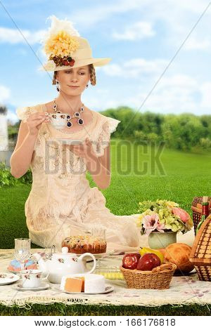 vintage edwardian woman with hat at picnic
