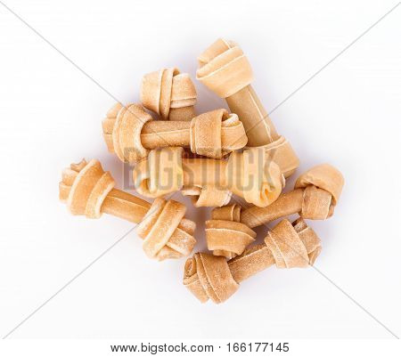 Artificial a bone for a dog with vitamins on white background