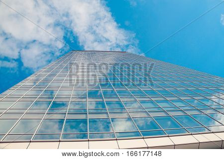 architecture with window building pattern with the reflection of sky for background .