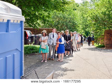 Charlottesville, USA - May 18, 2014: Crowd of people lined up to use restroom at graduation ceremony at University of Virginia