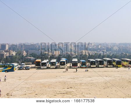 Giza, Egypt - June 30, 2008: Many tour buses parked to see the Sphynx statue and great pyramids