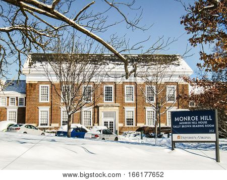 Charlottesville, USA - December 3, 2009: Monroe Hill sign covered in snow during winter at University of Virginia