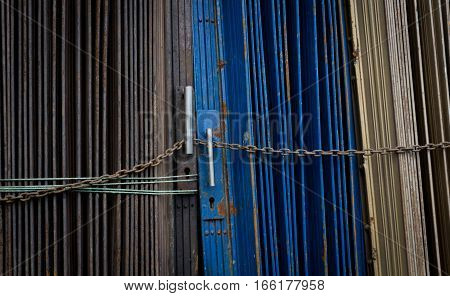 Blue and grey metal rolling door locked by chain photo taken in Jakarta indonesia java